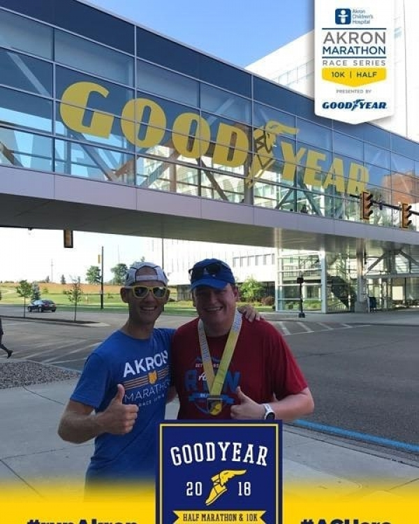 Jasen Sokol and Akron Marathon Race Director Brian Polen pose after finishing the Goodyear 10K course
