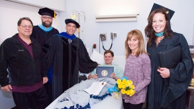 UA Student Graduates -- From Bed